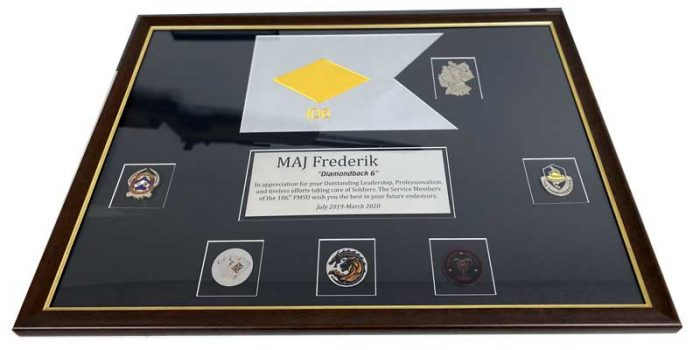 Frame with 106th FMSU Guidon and Coins | Trophy Center | Sandra Kulbick & J.R. Kulbick | Only in Kaiserslautern | Est. 1952 | Trophy Shop | 2 MILES FROM RAMSTEIN AIR BASE | GO OFF BASE TO THE AWESOME TROPHY CENTER | Engraving Frame Shop Coins Stamps Embroidery Guidons Awards Plaques Engraved Etched Signs Graveur Gravur Graviert Eingraviert | Kaiserslautern-Einsiedlerhof underneath Hacienda Mexican Restaurant | Stempel Gravuren Pokale Schilder | US Army | US Air Force | KMCC | Nato | Bundeswehr | Support Local | Stay Safe & Healthy | E-Mail: info@trophy-center.de