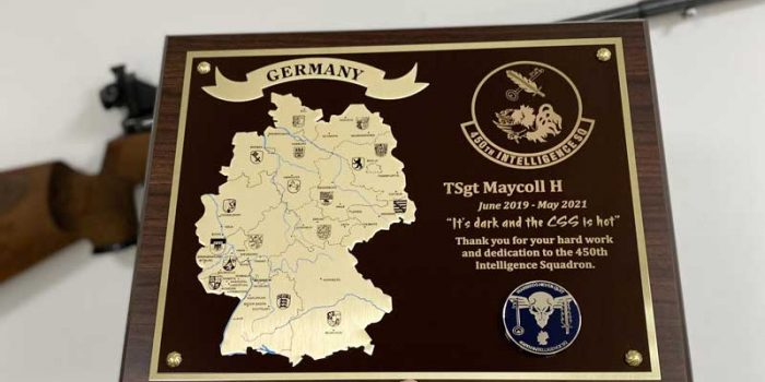 11215W Brass Brown on Gold GE Special   Trophy Center   Sandra Kulbick & J.R. Kulbick   Only in Kaiserslautern   Est. 1952   Trophy Shop   2 MILES FROM RAMSTEIN AIR BASE   GO OFF BASE TO THE AWESOME TROPHY CENTER   Engraving Frame Shop Challenge Coins Stamps Embroidery Guidons Awards Plaques Engraved Etched Signs Graveur Gravur Graviert Eingraviert   Kaiserslautern-Einsiedlerhof underneath Hacienda Mexican Restaurant   Stempel Gravuren Pokale Schilder   US Army   US Air Force   USSF Space Force   KMCC   Nato   Bundeswehr   Support Local   Stay Safe & Healthy   E-Mail: info@trophy-center.de