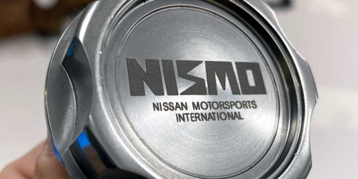 Nissan Nismo Old School Logo Oil Cap | Trophy Center | Sandra Kulbick & J.R. Kulbick | Only in Kaiserslautern | Est. 1952 | Trophy Shop | 2 MILES FROM RAMSTEIN AIR BASE | GO OFF BASE TO THE AWESOME TROPHY CENTER | Engraving Frame Shop Challenge Coins Stamps Embroidery Guidons Awards Plaques Engraved Etched Signs Graveur Gravur Graviert Eingraviert | E4 Mafia Friendly | Stempel Gravuren Pokale Schilder | US Army | US Air Force | USSF Space Force | KMCC | Nato | Bundeswehr | Support Local | Shop Local | Kaiserslautern-Einsiedlerhof underneath Hacienda Mexican Restaurant | No Charge Per Letter | No Charge Per Logo | Stay Safe & Healthy | E-Mail: info@trophy-center.de